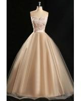 обемна рокля по поръчка в златисто шампанско