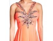 богато украсена бална рокля в корал модел 2017