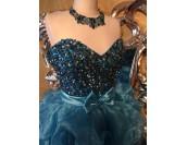 луксозна рокля в синьо с асиметричен дизайн и корсет изцяло обсипан с кристали