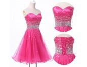 къса бална рокля с обем в наситено розово